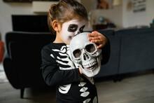 Adorable Little Skeleton Kissing Skull
