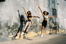 Fit Women Dancing On Street