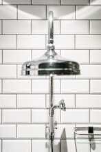 Detail Of A Shower Head Next To A Toilet Wall With Tiles