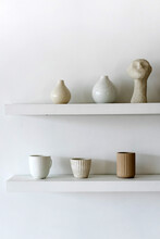 Set Of Ceramic Pots And Cups On Shelf