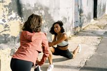 Sportswomen Lunging On Street