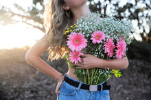 Teen Girl Holding Flowers