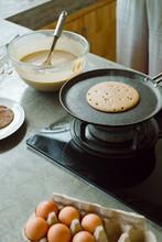 A Closeup Photo Of A Pancake In A Frying Pan