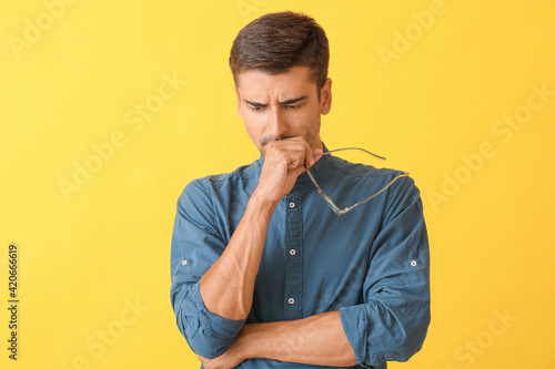 Fotografie, Tablou Portrait of thoughtful young man on color background