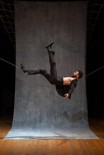 Circus Performer On A Slackwire In A Dynamic Pose