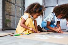 Black Girls Drawing On Carton