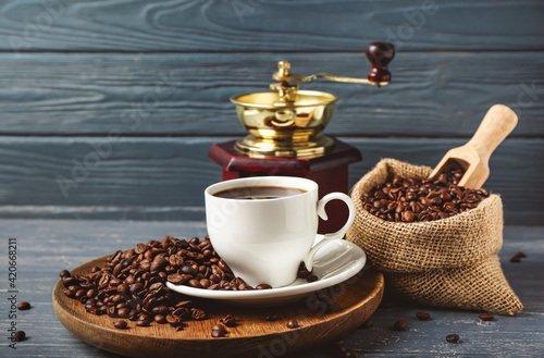 Composition with cup of hot coffee on dark wooden background Fotobehang
