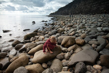 Girl Hunts For Fossils On The Jurassic Coast