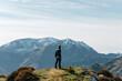 Unrecognizable man contemplating mountains