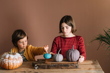 Kids Playing With Decorated Pumpkins