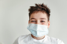 A Young Boy In A Protective Medical Mask.