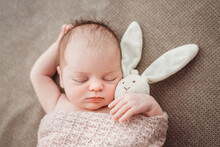 Cute Baby Sleeping With A Plush Bunny