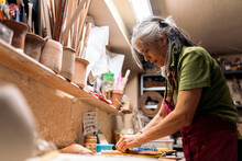 Woman Working In Pottery Workshop
