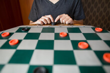 Child Plays Checkers