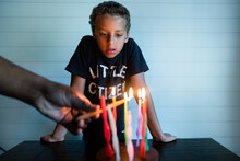 Child Watches Birthday Candles Being Lit