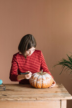 Girl Decorating A Pumpkin