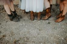 Close Up Of Bride And Bridesmaids Wearing Cowboy Boots