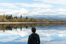 Portrait Of Male By Overlooking Beautiful Lake