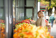 Woman Shopping For Fresh Fruit