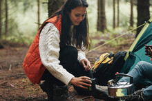 Woman Making Coffee While Camping