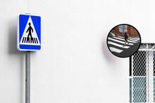 Crosswalk Signal And Pedestrian Crossing In Mirror.