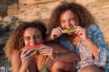 Twin Sisters Eating Watermelon