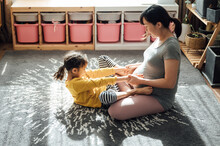 Pregnant Woman And Daughter At Home