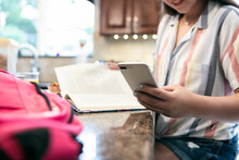 Morning: Focus On Phone As Girl Checks Text Messages