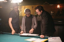 A Film Crew Reviews A Script Before Filming