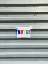 Handmade VOTE Sign On Building Exterior
