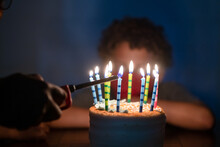 Hand Lights Candles On Birthday Cake