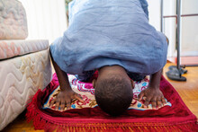 Black Muslim Praying At Home.