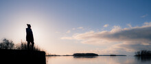 Silouhette Finnish Girl Standing On On Natural Piers