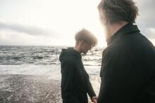 Young Couple Walking At Sea Shore