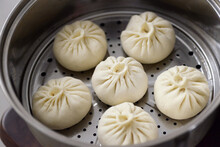 The Process Of Making Delicious Steamed Buns, Steamed Buns In A Steamer.