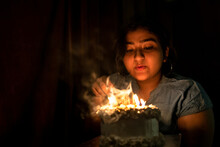 Smiling Birthday Girl With Candles Indoor