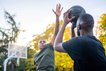 Two Friends Playing Basketball.