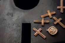 Golden Crosses For Jewelry/jewellery Pendants Are Seen In A Jewellery Factory On A Dark Metal Block.