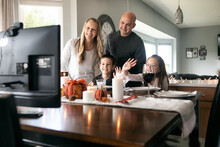 Thanksgiving: Family Waves To Relatives On Distanced Video Chat
