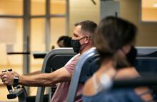 Gym: Man Wears Mask While Working Crunch Machine