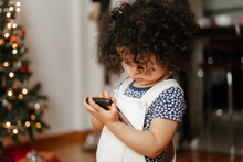 Little Girl Using An Android Cellphone
