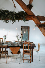 Dinner Or Lunch Table Indoors With Mismatched Chairs