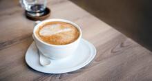 Cappuccino Coffee On Table Morning Serve On Ceramic Cup