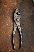 A Pair Of Pliers In A Jewellery Factory Seen On An Old Wooden Workbench