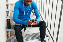 Fit Man Checking His Phone After A Workout