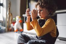 Boy Playing With Digital Camera