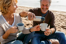 Mature Couple Having A Picnic At The Beach