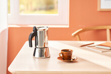 Freshly Brewed Coffee In Cup And Coffeemaker