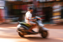 Traffic In India. Intentionally Blurred Motion Of A Motorbike.