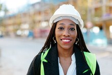 Portrait Of Attractive Black Woman Wearing Protective Safety Helmet Smiling And Looking At Camera